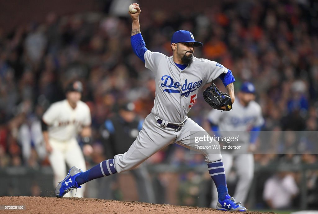 Sergio Romo #54 of the Los Angeles Dodgers pitches against the San Francisco Giants in the bottom of the seventh inning at AT&T Park on April 26, 2017 in San Francisco, California.