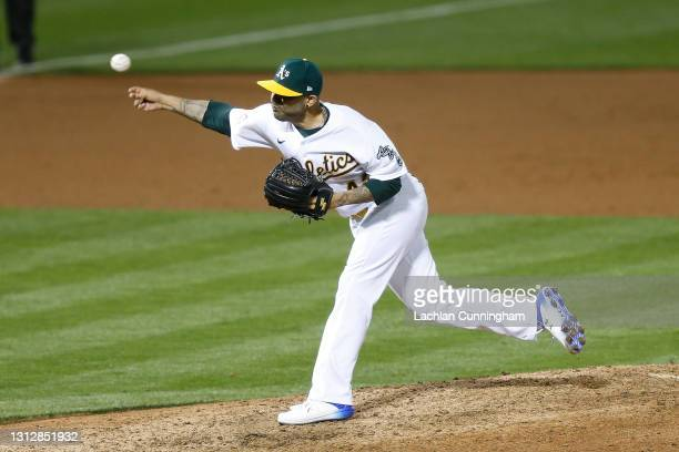 Sergio Romo of the Oakland Athletics pitches against the Detroit Tigers at RingCentral Coliseum on April 15, 2021 in Oakland, California. All players...