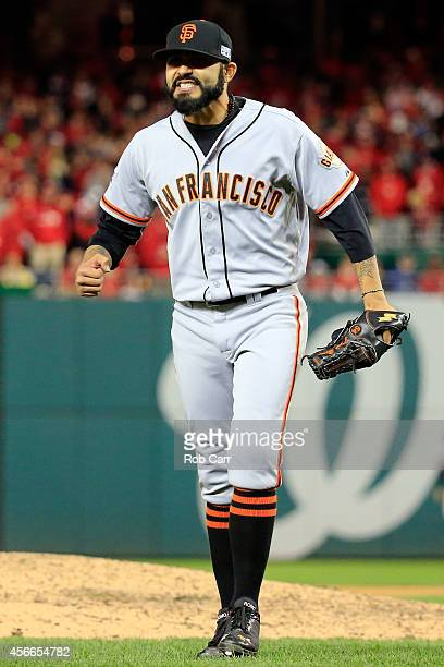 Sergio Romo of the San Francisco Giants celebrates after coming of the mound in the ninth inning against the Washington Nationals during Game Two of...