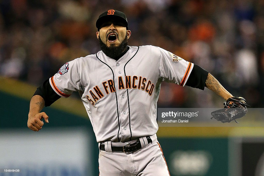Sergio Romo #54 of the San Francisco Giants celebrates after defeating the Detroit Tigers in Game Three of the Major League Baseball World Series at Comerica Park on October 27, 2012 in Detroit, Michigan. The San Francisco Giants defeated the Detroit Tigers 2-0.