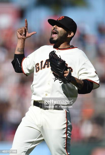 Sergio Romo of the San Francisco Giants celebrates after defeating the Philadelphia Phillies 65 at ATT Park on August 16 2014 in San Francisco...