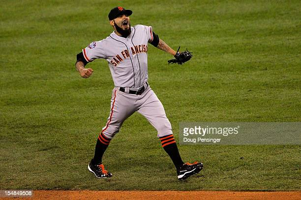 Sergio Romo of the San Francisco Giants celebrates after striking out Omar Infante of the Detroit Tigers to win Game Three of the Major League...
