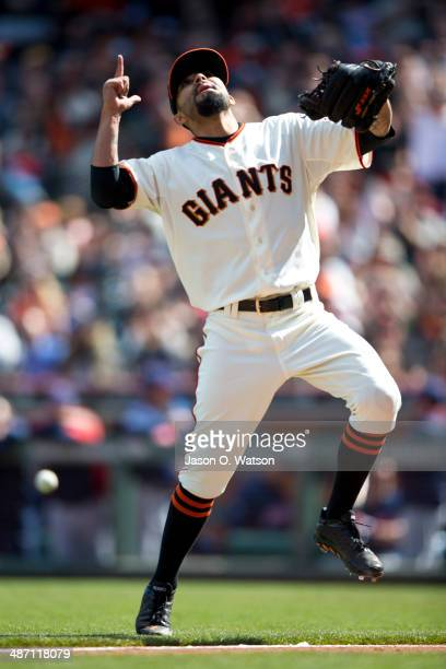 Sergio Romo of the San Francisco Giants celebrates after striking out Carlos Santana of the Cleveland Indians during the ninth inning at ATT Park on...