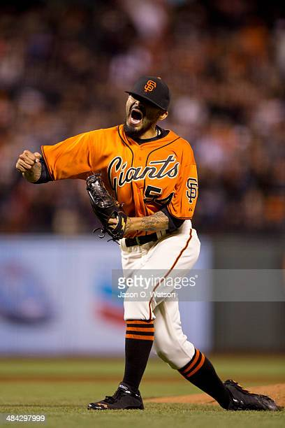 Sergio Romo of the San Francisco Giants celebrates after the game against the Colorado Rockies at ATT Park on April 11 2014 in San Francisco...