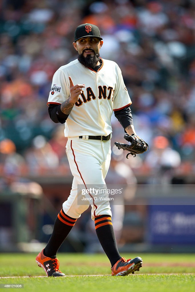 Sergio Romo #54 of the San Francisco Giants celebrates during the eighth inning against the San Diego Padres at AT&T Park on September 13, 2015 in San Francisco, California. The San Francisco Giants defeated the San Diego Padres 10-3.