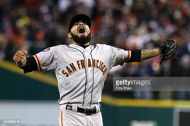 Sergio Romo of the San Francisco Giants celebrates striking out Miguel Cabrera of the Detroit Tigers to win Game Four of the Major League Baseball...