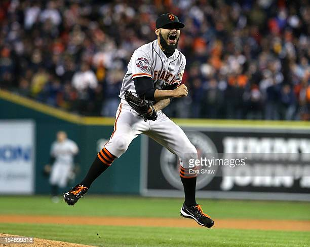 Sergio Romo of the San Francisco Giants celebrates striking out Miguel Cabrera of the Detroit Tigers in the tenth inning to win Game Four of the...