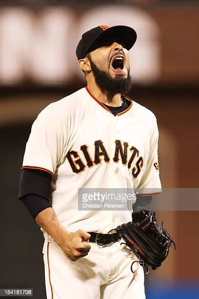 Sergio Romo of the San Francisco Giants celebrates their 7 to 1 win over the St Louis Cardinals in Game Two of the National League Championship...