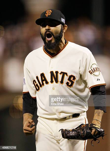 Sergio Romo of the San Francisco Giants celerates after the final out of the eighth inning against the Washington Nationals during Game Four of the...
