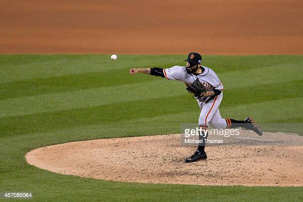 Sergio Romo of the San Francisco Giants pitches in the eighth inning against the St. Louis Cardinals during Game One of the National League...