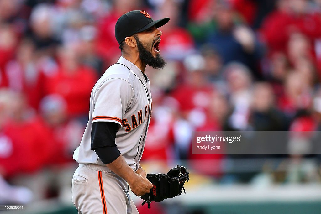 Sergio Romo #54 of the San Francisco Giants reacts after defeating the Cincinnati Reds by a score of 6-4 to win Game Five of the National League Division Series and advance to the NLCS at Great American Ball Park on October 11, 2012 in Cincinnati, Ohio.
