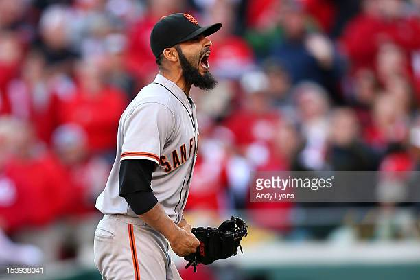 Sergio Romo of the San Francisco Giants reacts after defeating the Cincinnati Reds by a score of 64 to win Game Five of the National League Division...