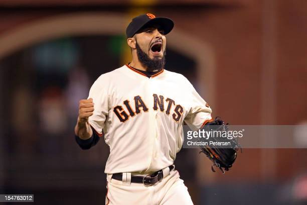 Sergio Romo of the San Francisco Giants reacts after Omar Infante of the Detroit Tigers fouled out for the final out of the game in the ninth inning...