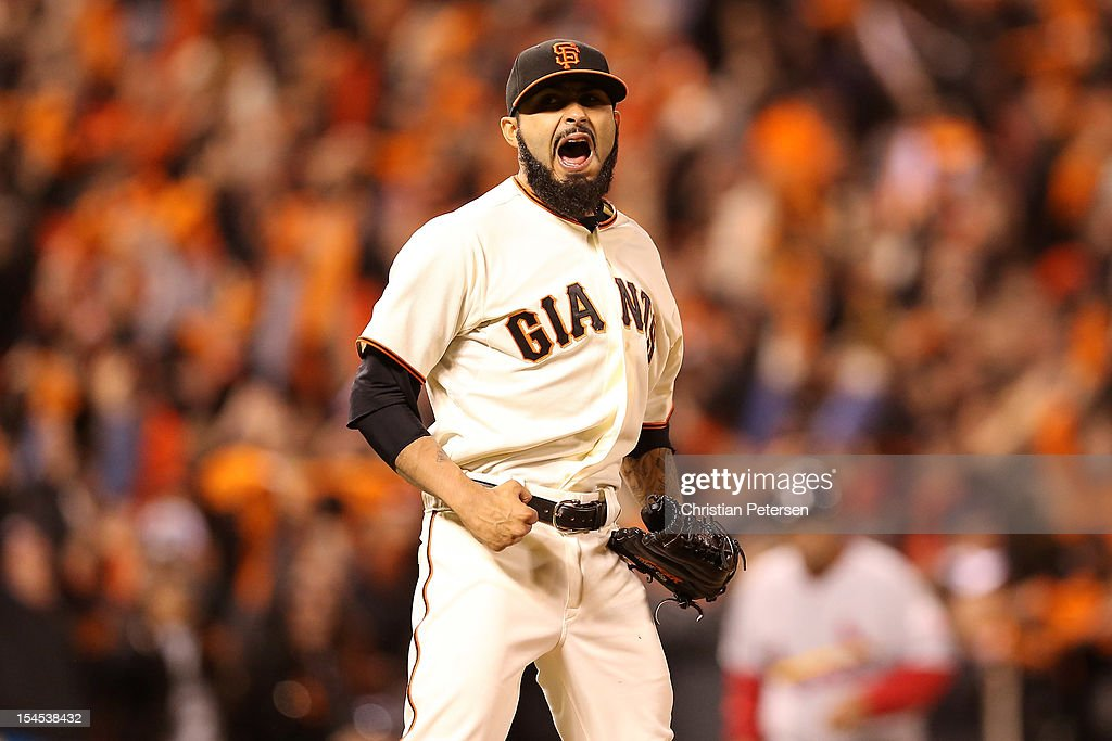 Sergio Romo #54 of the San Francisco Giants reacts after recording the last out as the Giants defeat the St. Louis Cardinals 6-1 in Game Six of the National League Championship Series at AT&T Park on October 21, 2012 in San Francisco, California.