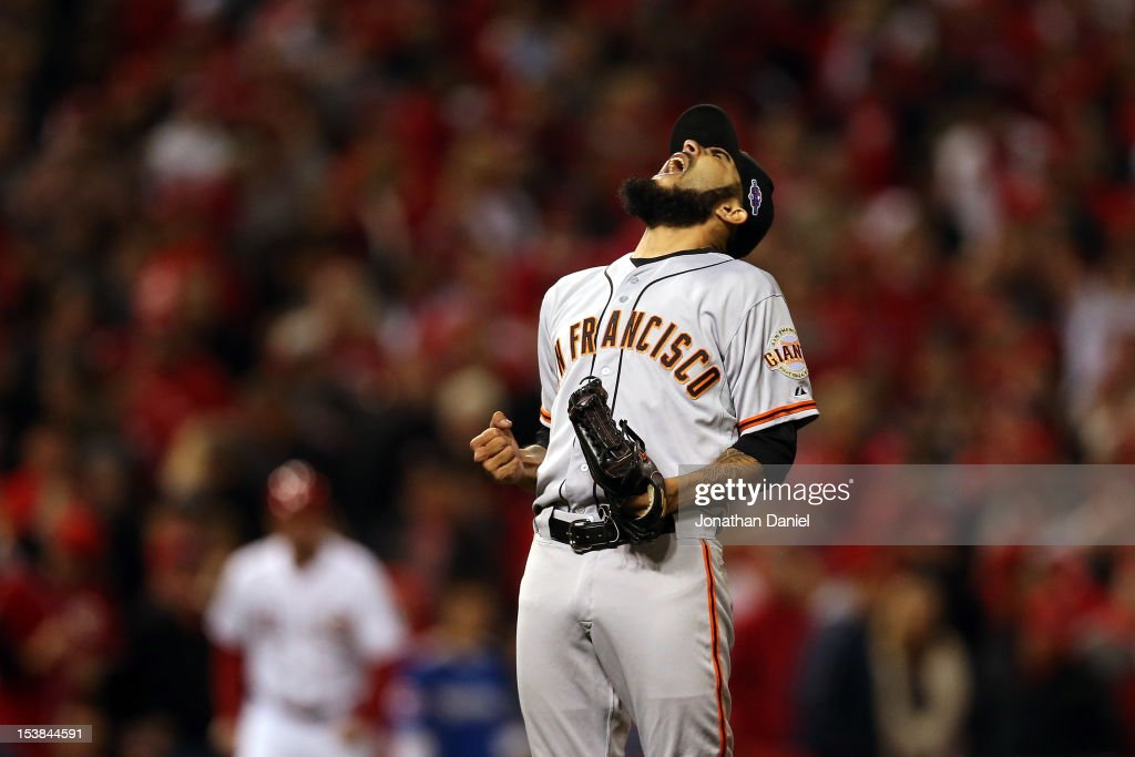 Sergio Romo #54 of the San Francisco Giants reacts after the Giants defeat the Cincinnati Reds 2-1 in the 10th inning in Game Three of the National League Division Series at the Great American Ball Park on October 9, 2012 in Cincinnati, Ohio. Romo earned the win in the victory.