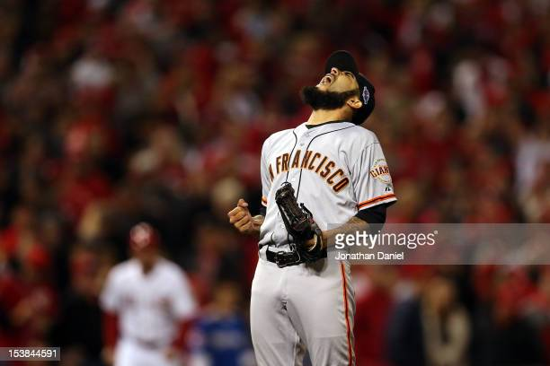 Sergio Romo of the San Francisco Giants reacts after the Giants defeat the Cincinnati Reds 21 in the 10th inning in Game Three of the National League...
