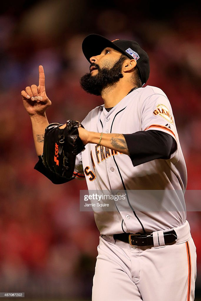 Sergio Romo #54 of the San Francisco Giants reacts in the eighth inning against the St. Louis Cardinals during Game One of the National League Championship Series at Busch Stadium on October 11, 2014 in St Louis, Missouri.