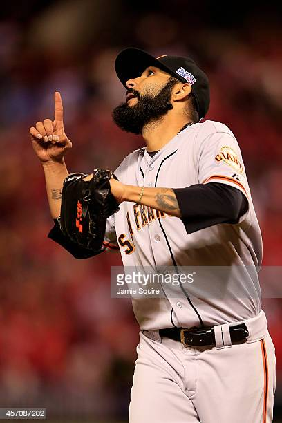 Sergio Romo of the San Francisco Giants reacts in the eighth inning against the St Louis Cardinals during Game One of the National League...