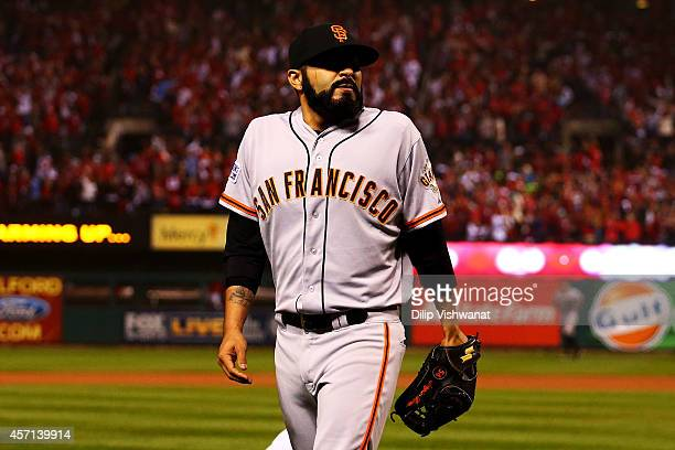 Sergio Romo of the San Francisco Giants walks to the dugout after their 5 to 4 loss to the St Louis Cardinals in Game Two of the National League...