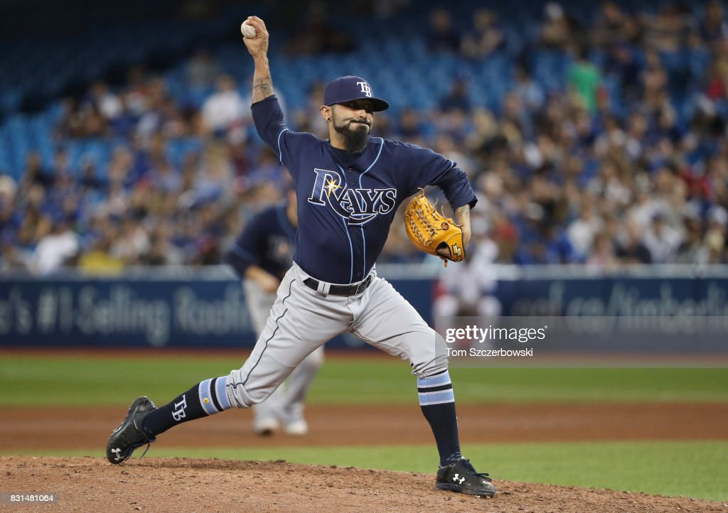 Sergio Romo #54 of the Tampa Bay Rays delivers a pitch in the seventh inning during MLB game action against the Toronto Blue Jays at Rogers Centre on August 14, 2017 in Toronto, Canada.