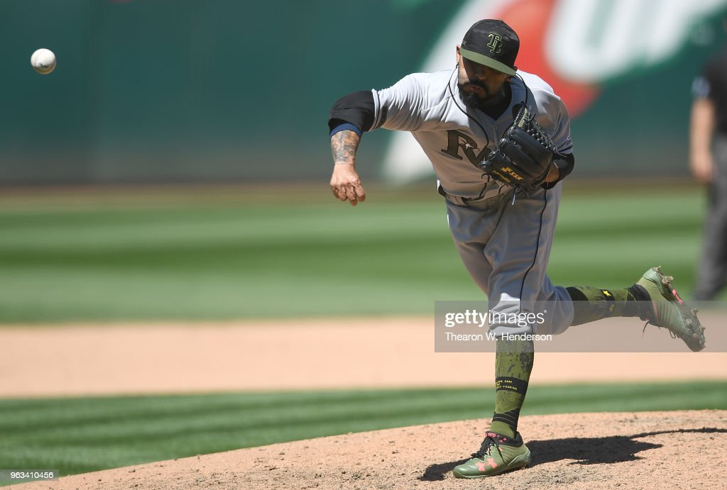 Sergio Romo #54 of the Tampa Bay Rays pitches against the Oakland Athletics in the bottom of the seventh inning at the Oakland Alameda Coliseum on May 28, 2018 in Oakland, California.