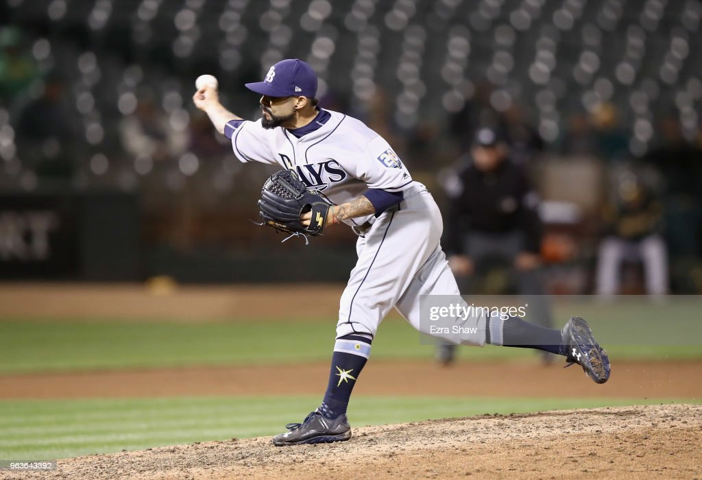 Sergio Romo #54 of the Tampa Bay Rays pitches against the Oakland Athletics in the ninth inning at Oakland Alameda Coliseum on May 29, 2018 in Oakland, California.