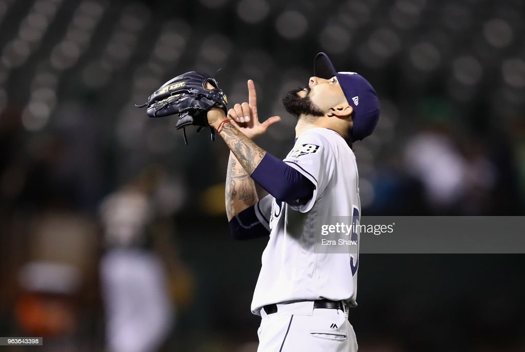 Sergio Romo #54 of the Tampa Bay Rays reacts after beating the Oakland Athletics at Oakland Alameda Coliseum on May 29, 2018 in Oakland, California.
