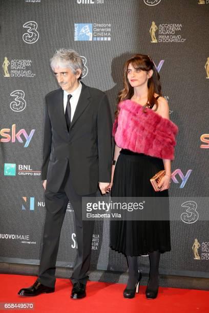Sergio Rubini and Carla Cavalluzzi walk the red carpet of the 61 David Di Donatello on March 27 2017 in Rome Italy