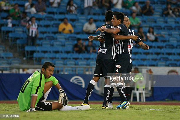 Sergio Santana of Monterrey celebrates with teammates a scored goal during a match against Comunicaciones as part of the Concacaf Champions League...