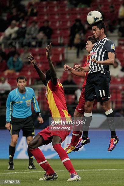 Sergio Santana of Monterrey competes for an aerial ball with Mohamed Ben Mansour of Esperance Sportive de Tunis during the FIFA Club World Cup 5th...
