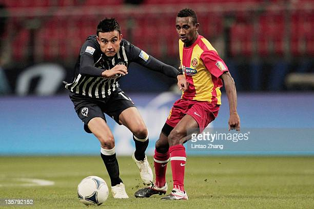 Sergio Santana of Monterrey controls the ball with Banana Yaya of Esperance Sportive de Tunis during the FIFA Club World Cup 5th Place match between...