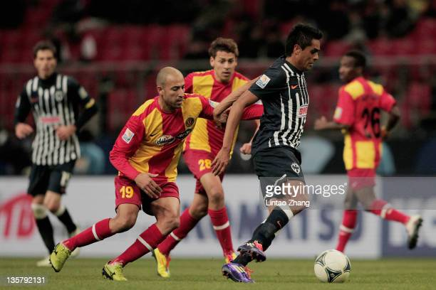 Sergio Santana of Monterrey is challenged by Khaled Mouelhi of Esperance Sportive de Tunis during the FIFA Club World Cup 5th Place match between...