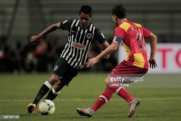 Sergio Santana of Monterrey is challenged by Khelil Chammam of Esperance Sportive de Tunis during the FIFA Club World Cup 5th Place match between...