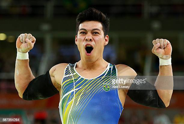 Sergio Sasaki of Brazil celebrates after competing on the parallel bars during the men's team final on Day 3 of the Rio 2016 Olympic Games at the Rio...