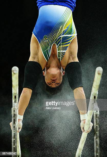 Sergio Sasaki of Brazil competes on the parallel bars during the men's team final on Day 3 of the Rio 2016 Olympic Games at the Rio Olympic Arena on...