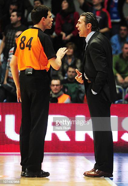 Sergio Scariolo Head Coach of BC Khimki Moscow Region talks to the referee Nicolas Maestre during the 20102011 Turkish Airlines Euroleague Regular...