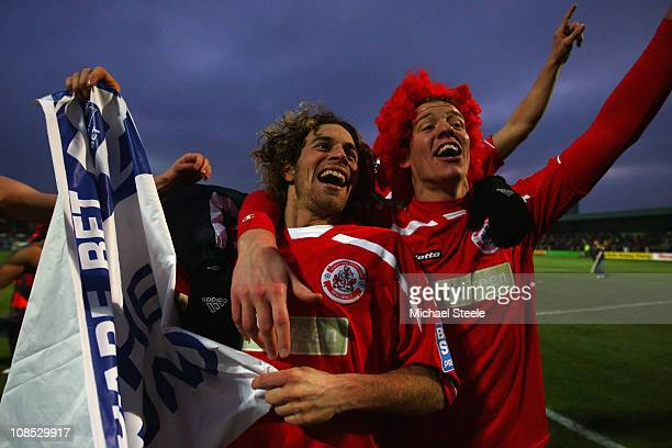 Sergio Torres and Glenn Wilson of Crawley Town celebrate their 10 victory during the FA Cup sponsored by EON 4th round match between Torquay United...