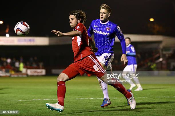 Sergio Torres of Crawley Town battles with Brad Potts of Carlisle United during the Sky Bet League One match between Crawley Town and Carlisle United...