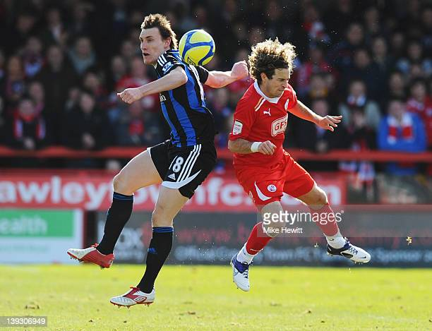 Sergio Torres of Crawley Town battles with Dean Whitehead of Stoke City during the FA Cup with Budweiser Fifth Round match between Crawley Town and...