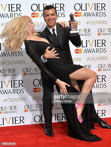 Sergio Trujillo and Pixie Lott pose in the winners room at The Olivier Awards at The Royal Opera House on April 12 2015 in London England