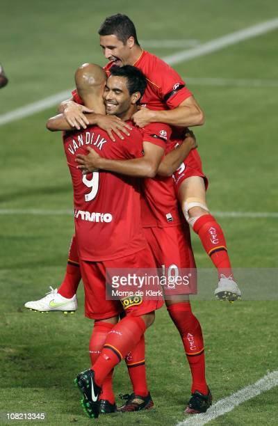 Sergio Van Dijk Marcos Flores and Mathew Leckie of Adelaide celebrate a third goal by Van Dijk during the round 24 ALeague match between Adelaide...