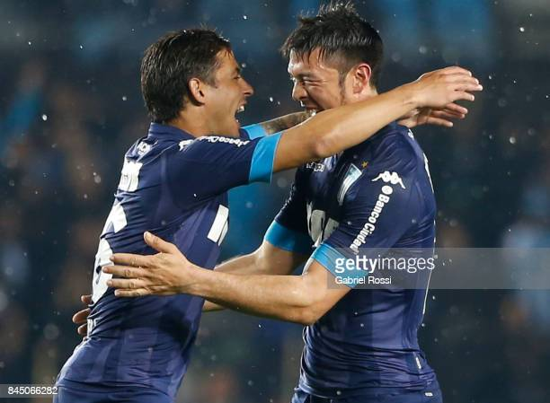 Sergio Vittor of Racing Club celebrates with teammates after scoring the third goal of his team during a match between Racing Club and Temperley as...