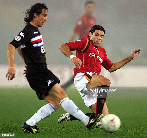 Sergio Volpi of Sampdoria attempts to control the ball from Simone Perrotta of Roma during the Serie A Roma v Sampdoria match on December 5 2004 at...