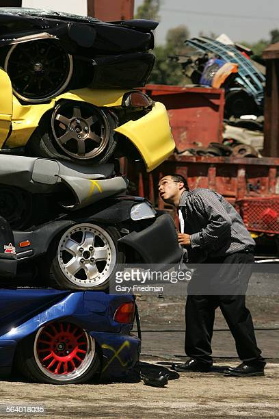 Sergio Zavala looks at what remains of his 1993 Honda Civic SI after it was crushed on Wednesday 6/20/07 Six cars that were impounded during illegal...