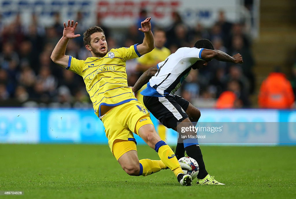 Sergiu Bus of Sheffield Wednesday vies with Vurnon Anita of Newcastle United during the Capital One Cup Third Round match between Newcastle United and Sheffield Wednesday at St James Park on September 23, 2015 in Newcastle, England.