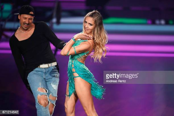 Sergiu Luca and AnnKathrin Broemmel perform on stage during the 5th show of the tenth season of the television competition 'Let's Dance' on April 21...