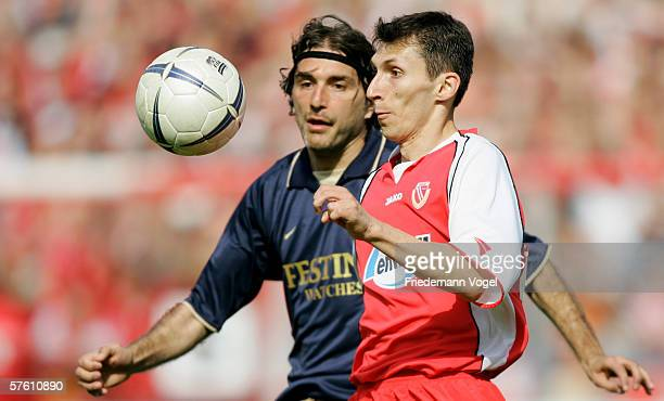 Sergiu Radu of Cottbus challenges for the ball with Slobodan Komljenovic of 1860 during the Second Bundesliga match between Energie Cottbus and 1860...