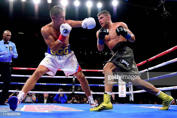 Sergiy Derevyanchenko exchanges punches with Gennady Golovkin during their IBF middleweight title bout at Madison Square Garden on October 05 2019 in...