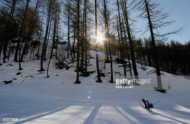 Sergiy Khyzhnyak of the Ukraine competes in the Men's 75 KM Sitting Biathlon during Day Four of the Turin 2006 Winter Paralympic Games on March 14...