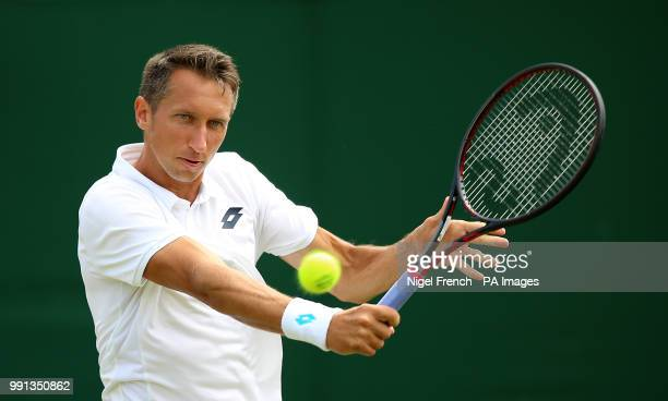 Sergiy Stakhovsky in action on day three of the Wimbledon Championships at the All England Lawn Tennis and Croquet Club Wimbledon